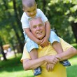 Happy grandfather and child in park — Stock Photo #54158661