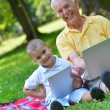 Grandfather and child using laptop — Stock Photo #54213257