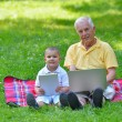 Grandfather and child using laptop — Stock Photo #54213649