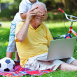 Grandfather and child using laptop — Stock Photo #54213767