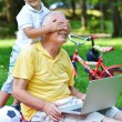 Grandfather and child using laptop — Stock Photo #54214079