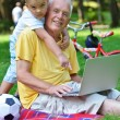 Grandfather and child using laptop — Stock Photo #54214107