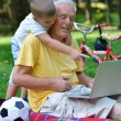 Grandfather and child using laptop — Stock Photo #54214251