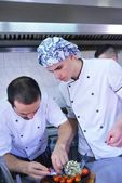 Two handsome chefs at kitchen — Stock Photo