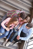 Happy teens group in school — Photo