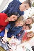 Happy teens group in school — Stock Photo