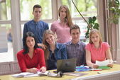 Happy teens group in school — Photo