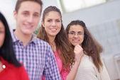 Happy teens group in school — Zdjęcie stockowe