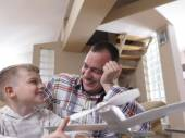 Father and son assembling airplane toy — Stock Photo