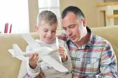 Father and son assembling airplane toy — Stockfoto