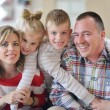 Happy young family at home — Stock Photo #58558115