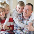 Happy young family at home — Stock Photo #58558519