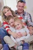 Happy young family at home — Fotografia Stock