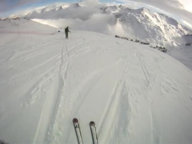 Skier going downhill  with camera on his helmet — Stock Video