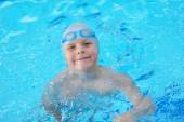 Young boy portrait at swimming pool — Stock Photo
