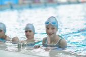 Happy kids at swimming pool — Stock Photo