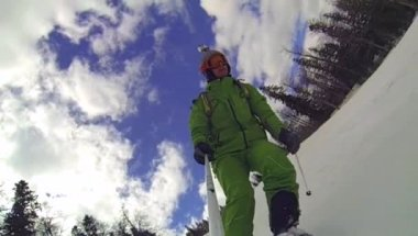 Ski sport, man going downhill with camera — Stock Video