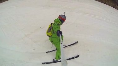 Ski sport, man going downhill with camera — Wideo stockowe