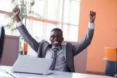 Business man at bright modern office — Stok fotoğraf