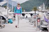 Young woman walking in marina — Foto de Stock
