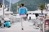 Young woman walking in marina — Stok fotoğraf
