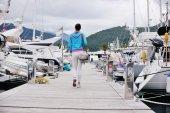 Young woman walking in marina — Stock Photo