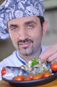 Chef and fish meal — Stock Photo
