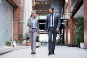 Business man and woman walking — Stock Photo