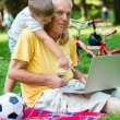 Grandfather and child using laptop computer — Stock Photo #65942071