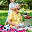 Grandfather and child using laptop computer — Stock Photo #65942151