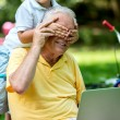 Grandfather and child using laptop computer — Stock Photo #65943277