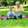 Grandfather and child using laptop and tablet computer — Stock Photo #65947065
