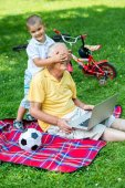 Grandfather and child using laptop computer — Stock Photo