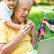 Grandfather and child using laptop computer — Stock Photo #65952851