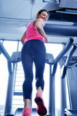 Woman exercising on treadmill in gym — Foto de Stock