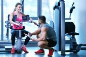 Woman exercising with her personal trainer — Stock Photo