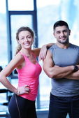 Attractive couple at the gym — Stock Photo