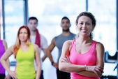Group of people exercising at the gym — Stock Photo