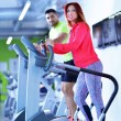 Young man and woman working out — Stok fotoğraf #67546875