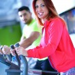 Young man and woman working out — Stok fotoğraf #67547045