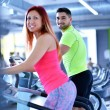 Young man and woman working out — Stock Photo #67547437