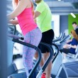 Young man and woman working out — Stok fotoğraf #67547543