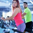 Young man and woman working out — Stock Photo #67547699