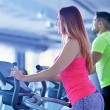 Young man and woman working out — Stock Photo #67547769