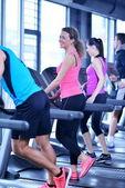Group of people on treadmills — Stock Photo