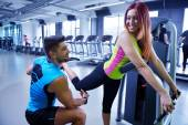 Woman exercising with her personal trainer — ストック写真