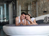 Couple relax and have fun in bed — Stockfoto