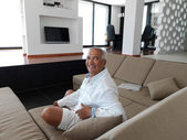 Portrait of senior man relaxing in sofa — Stock Photo