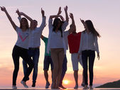 Party people at sunset — Stock Photo