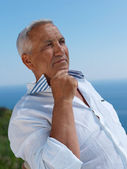 Senior man sitting outside — Stock Photo